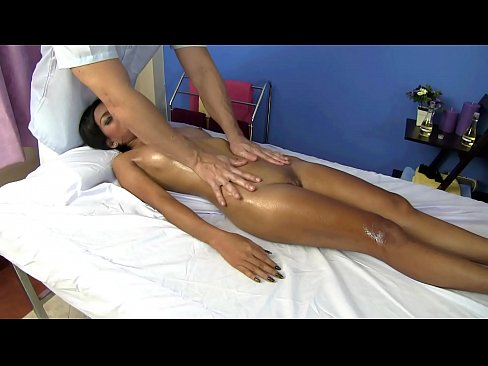 Asian girl with large pussy has sex on massage table