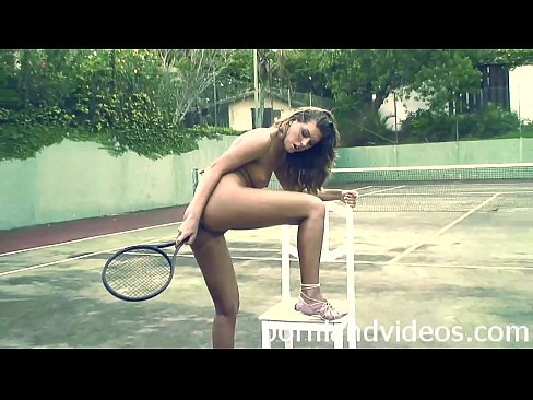 A Girl Playing With Her Tennis Racket