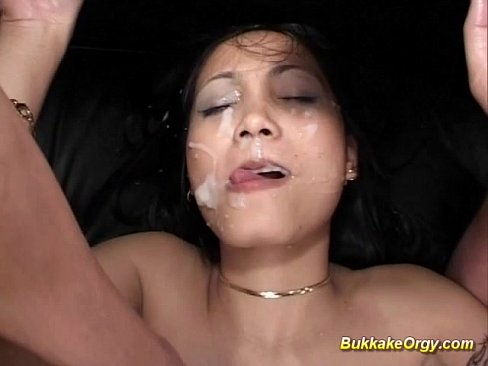 Asian gets bukkake on face and ass