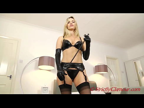Blonde Bombshell Mistress Natasha Teaches You A Lesson In Pain As Well As Pleasure In Sexy Stockings Latex Panties and Rubber Boots Armed With A Whip
