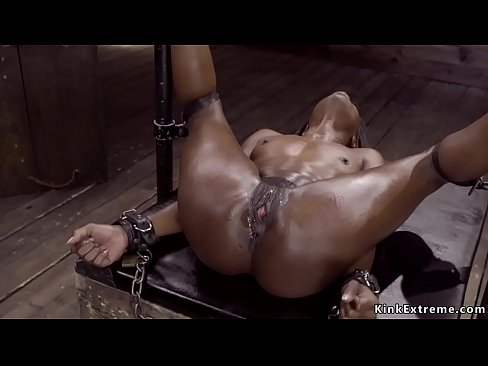 Ebony in device bondage is toyed