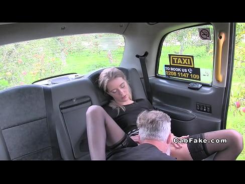 Slim hottie in stockings in fake taxi bangs