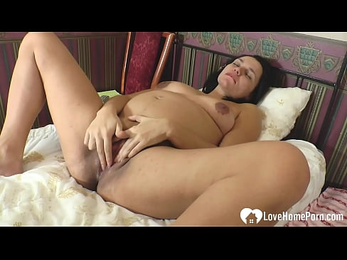 Lonely pregnant MILF playing with her tight pussy