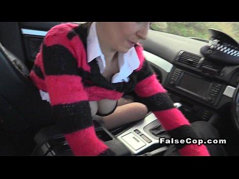 Tattooed babe fucks in police car in public