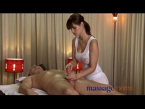 Massage Rooms Rita oils up her huge juicy breasts on a big throbbing cock