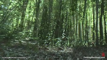 Two babes fucking machine in woods
