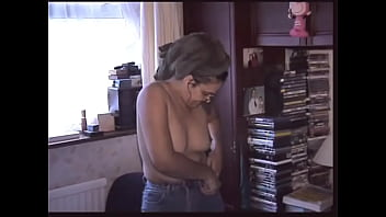 Indian woman getting dressed