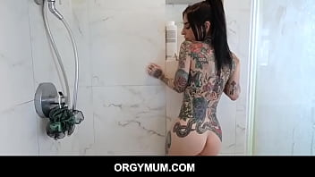Big tits Inked Stepmom giving stepson a blowjob and makes him fuck her pussy