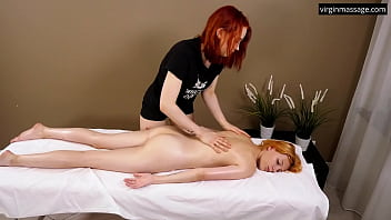 Felenk Roka enjoys her legs and back rubbed with oil