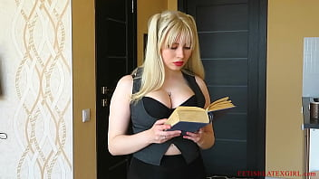Blonde Selesta is reading a book and posing in stockings and a transparent skirt
