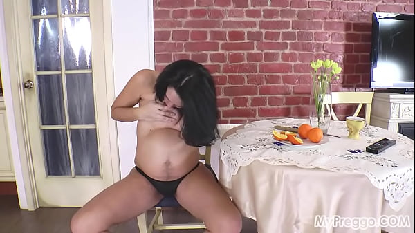 Knocked-Up Nina Plays with Her Hairy Pussy