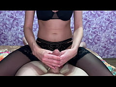 A girl jerks off a dick and gets cum on pantyhose